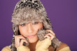 Pretty woman in fur trimmed winter hat