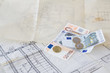 Architectural plans and euro money