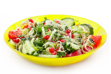 Fresh vegetable salad in yellow bowl