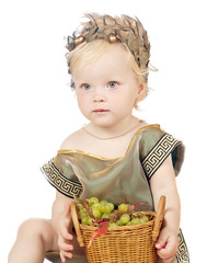 girl in a greek fancy dress with pottle of fruit