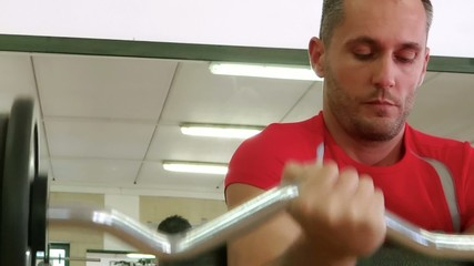 doing exercise with barbell