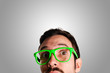 thoughtful man with green eyeglasses