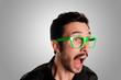 man screaming with green eyeglasses