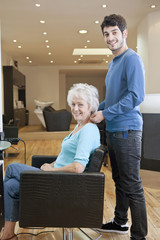 A male hairdresser and female client in a hairdressing salon