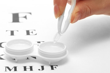 contact lenses in containers and tweezers, ,
