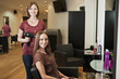 A female hairdresser and female client in a hairdressing salon