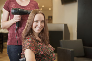 A female client showing off her new haircut