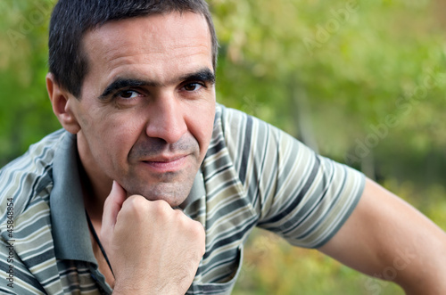 Attractive man sitting tinking