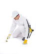 construction worker in white coveralls trowel tools in