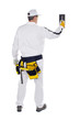 construction worker in white coveralls wall putty trowel hammer