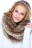 Gorgeous blond woman wearing fur scarf and smiling