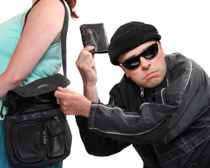 Thief stealing from handbag of a woman.
