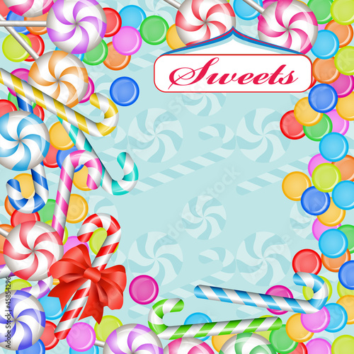 Mixed colorful candies and ribbon