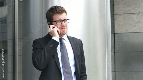 Businessman speaking at the phone