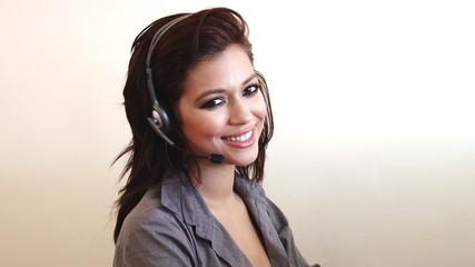 Pretty happy customer service woman smiling