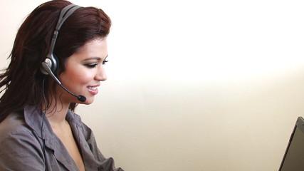 Sexy customer service woman at call center