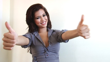 Sexy business woman with thumbs up success gesture