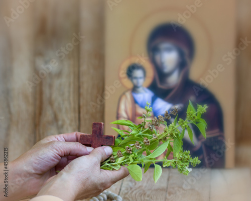Woman praying with wooden croos in hands
