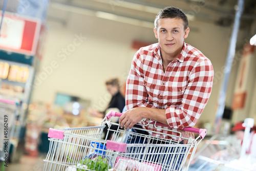 man at supermarket dairy shopping