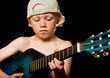 Boy playing the guitar