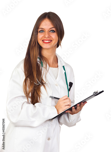 Beautiful young doctor writing in a folder