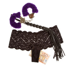 Fluffy purple handcuffs, a whip, money and panties, prostitution