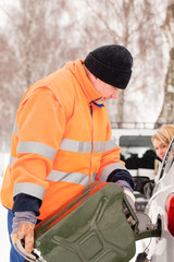 Man filling woman car gas winter assistance