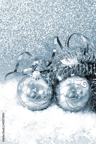 silver christmas balls with christmas tree