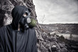 Portrait of a man in a gas mask and hood