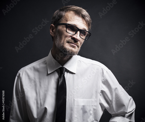 portrait of a man with a beard wearing glasses