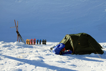 Tent in winter mountains.