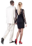 Back view of going young business couple