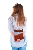 back view of standing redhaired woman with  notebook looking
