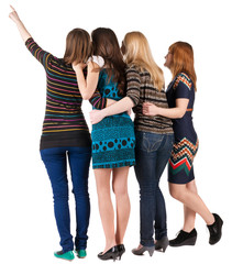 Back view of group beautiful women pointing at wall.