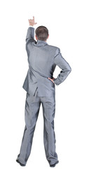 Back view of businessman pointing at wall