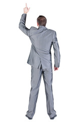 Back view of businessman pointing at wall.