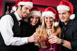 Christmas party friends at bar toast champagne - 45877246