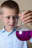 child is doing experiments in chemistry