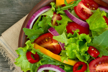 Fresh Salad in a bowl on wooden background