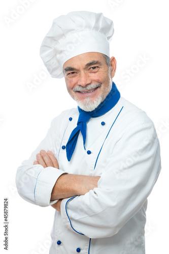 Koch mit verschränkten Armen