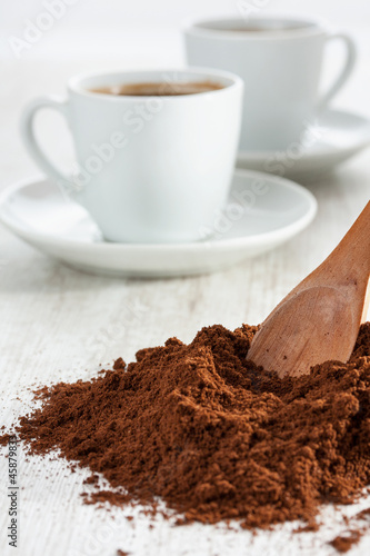 Freshly ground coffee and a cup