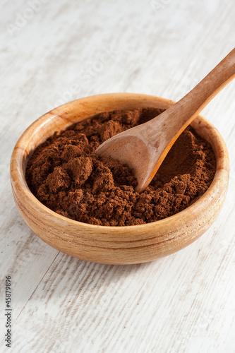 Freshly ground coffee in a bowl
