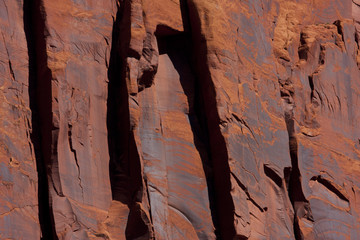 red stone rock wall shadows in the moab desert