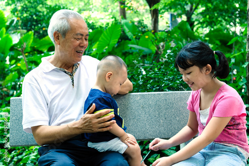 Asian grandfather with two grandchildren