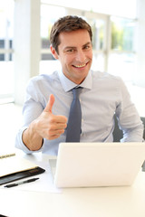 Businessman showing thumb up