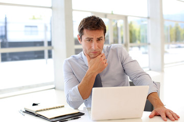 Businessman at work with preoccupied look