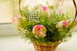 Beautiful bouquet of white and pink roses in a basket
