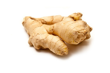 Root ginger isolated on a white studio background.