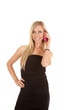 woman black dress smile pink phone