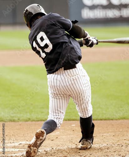 Baseball batter swinging